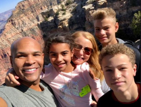 Jerome Adams with his wife and children