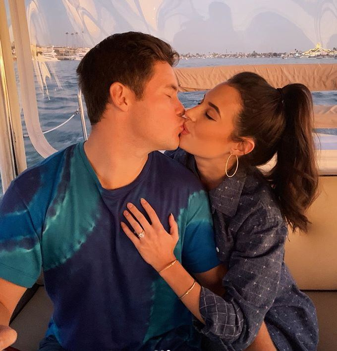 Chloe Bridges with her fiance, Adam Devine. | Source: Instagram.com