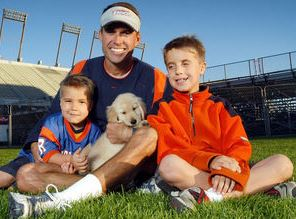 Chris Petersen with Children}}