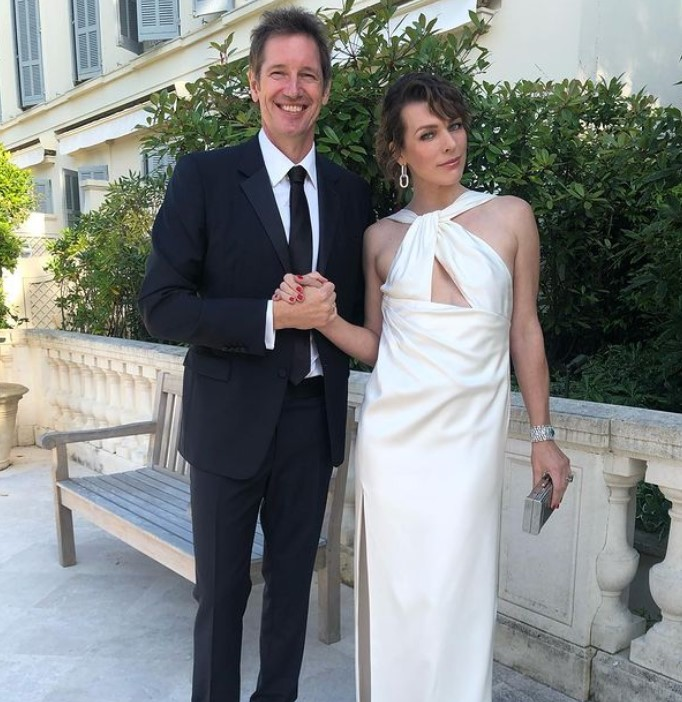 Milla Jovovich with her husband Paul | Source: Milla's Instagram